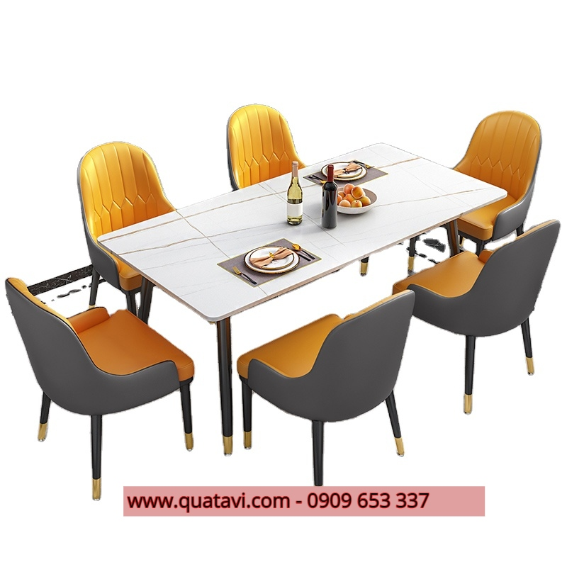 a dining room table and chairs